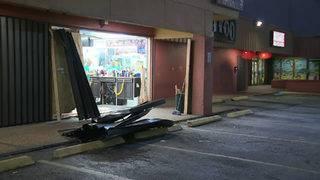 Pickup truck crashes into Miami barbershop