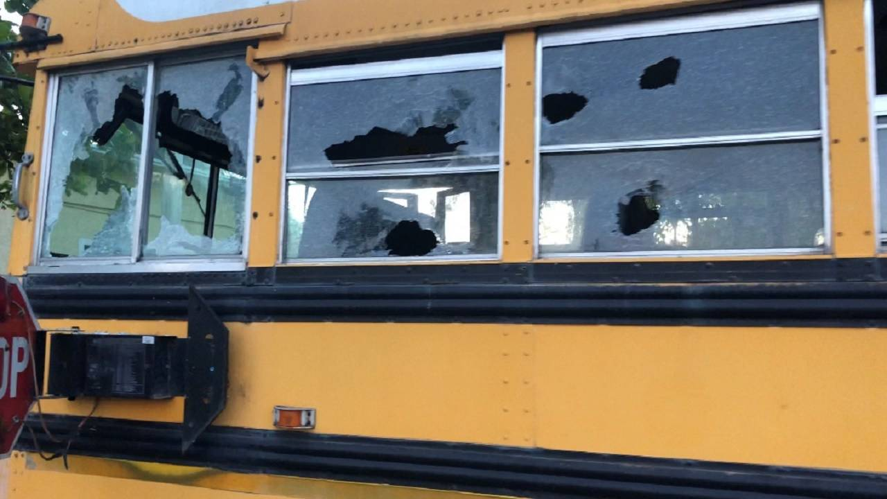 Smashed windows on school bus at private school