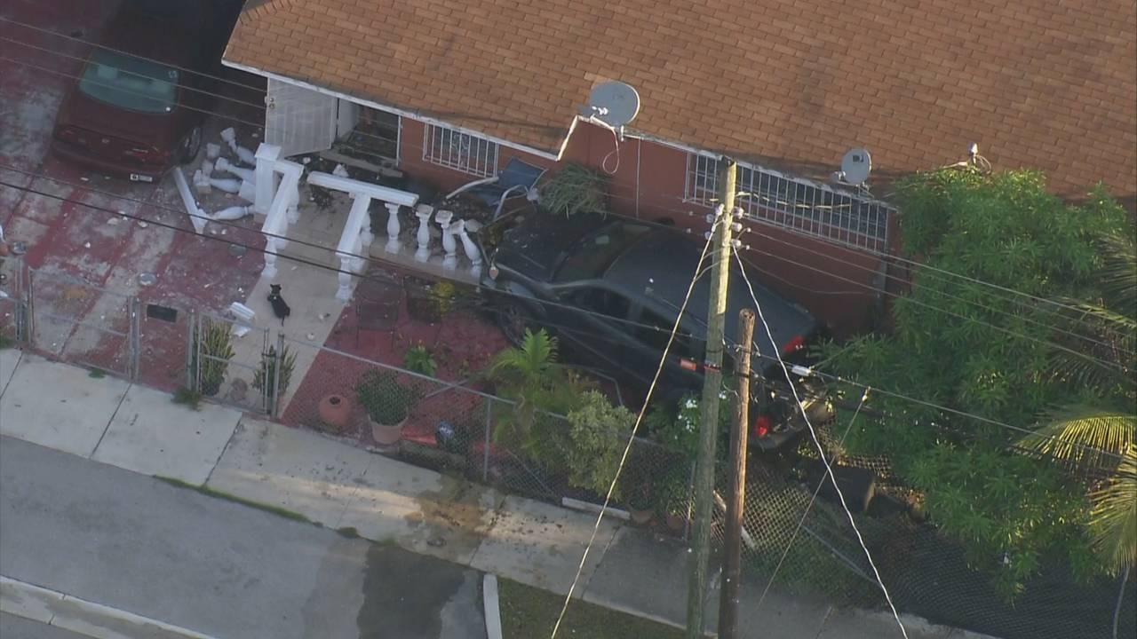 Sky 10 SUV crashes into front of home in Miami