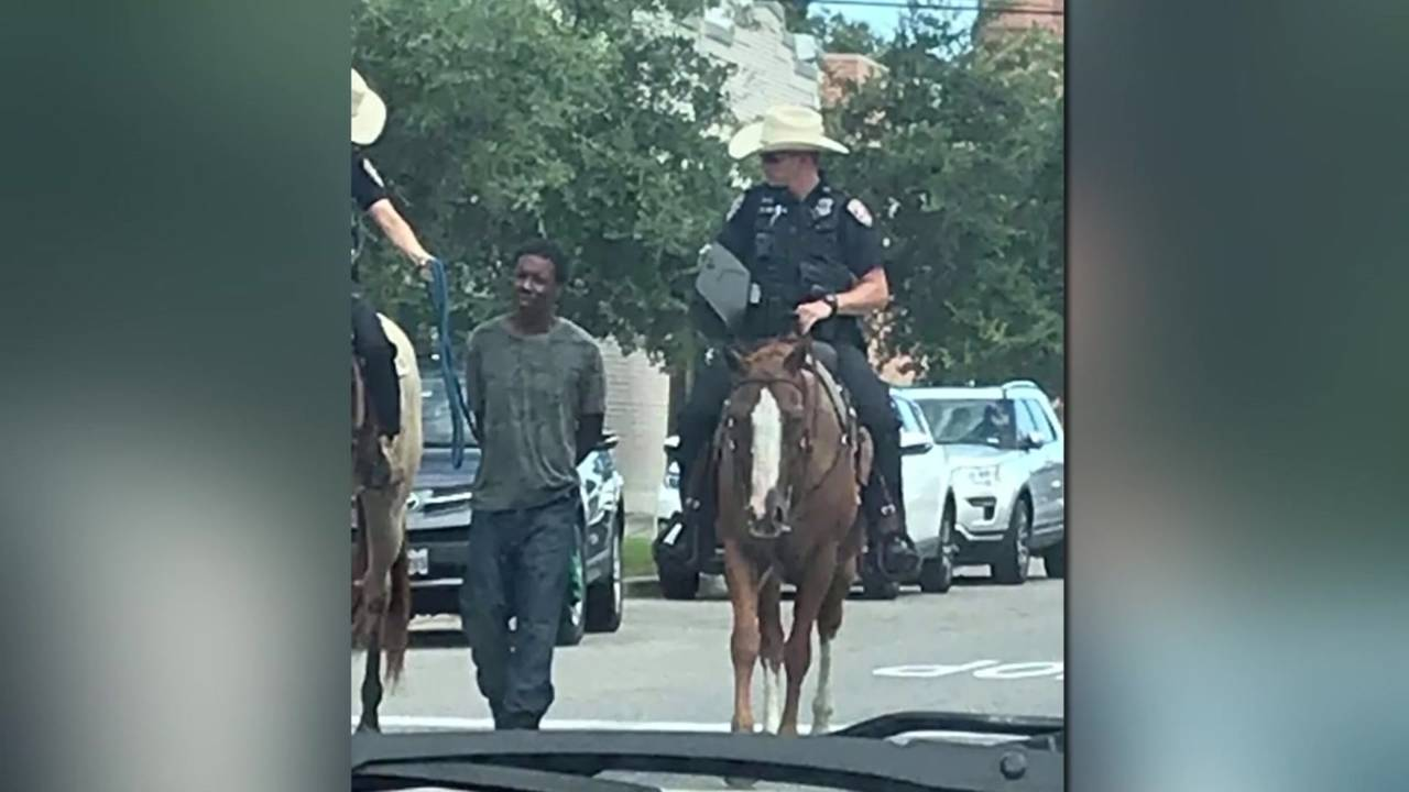donald neely being led by galveston Mounted Patrol