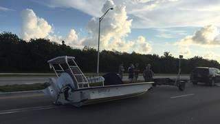 Boat falls off trailer, lands on road in Marathon