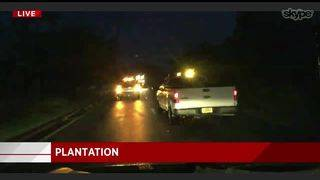 Plantation crews work on clearing roads after Hurricane Irma