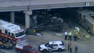 Big rig can't clear I-4 overpass in Longwood, crashes and flips