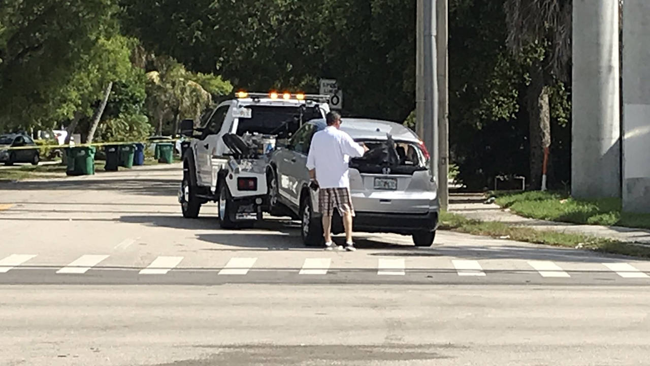 Garbage truck slams into building in South Miami 3