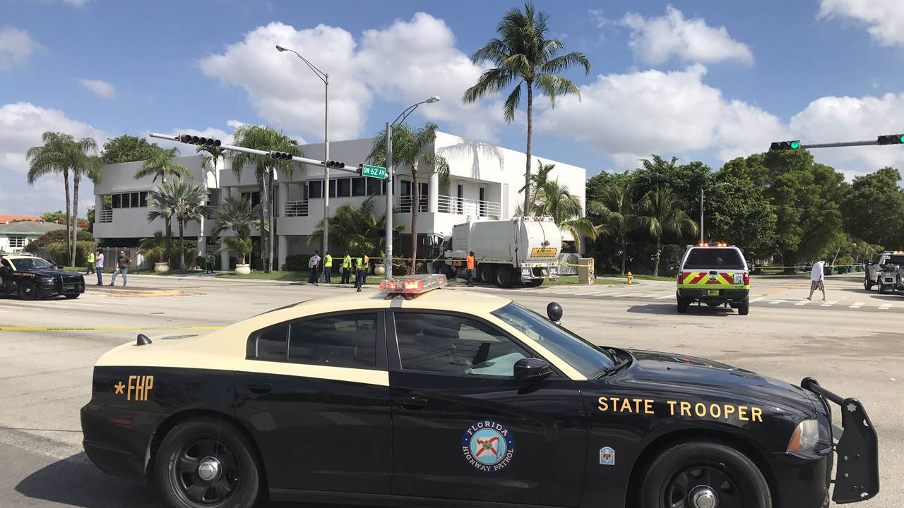 Garage truck slams into building in South Miami