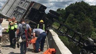 Part of dump truck hangs off I-75 overpass after crash in Sumter