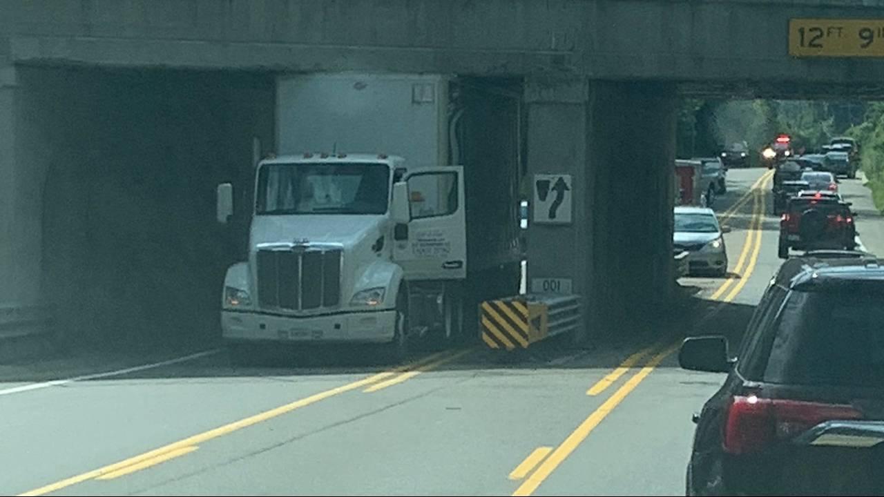 Semi truck stuck under intersection at Big Beaver 2
