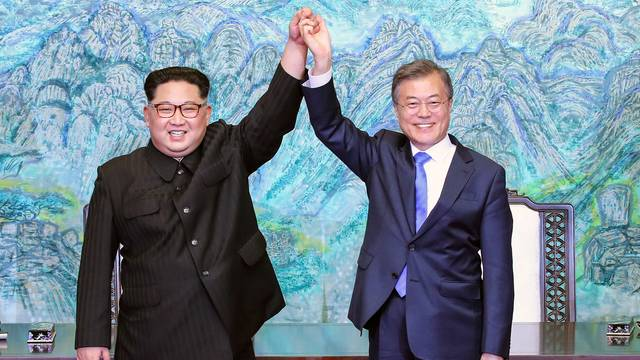 Image result for North and South Korean leaders hold surprise meeting