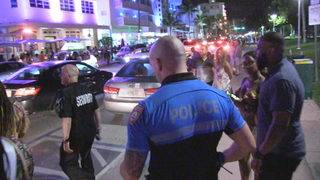 Miami Beach added extra officers. Now business owners want them to stay