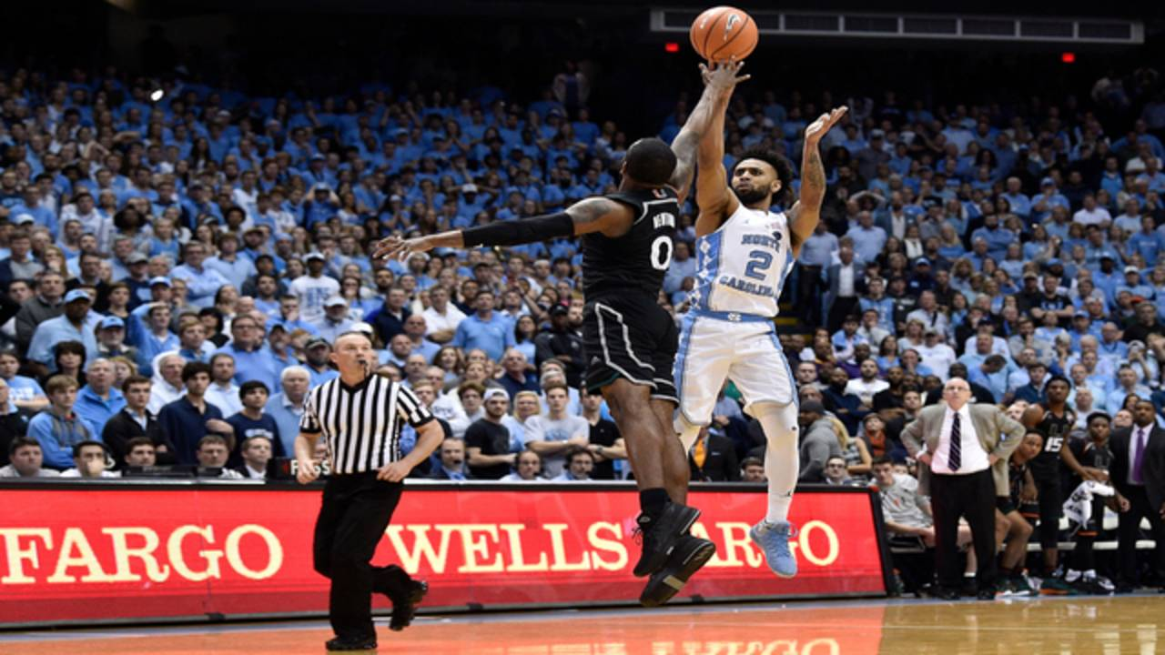 North Carolina Tar Heels Joel Berry II shoots over Miami Hurricanes Ja'Quan Newton