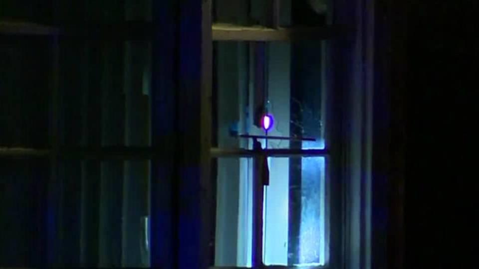 officers shot Detroit window lesure street_1492424413129.jpg