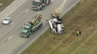 Cherry picker rolls onto side on Sawgrass Expressway in Coral Springs