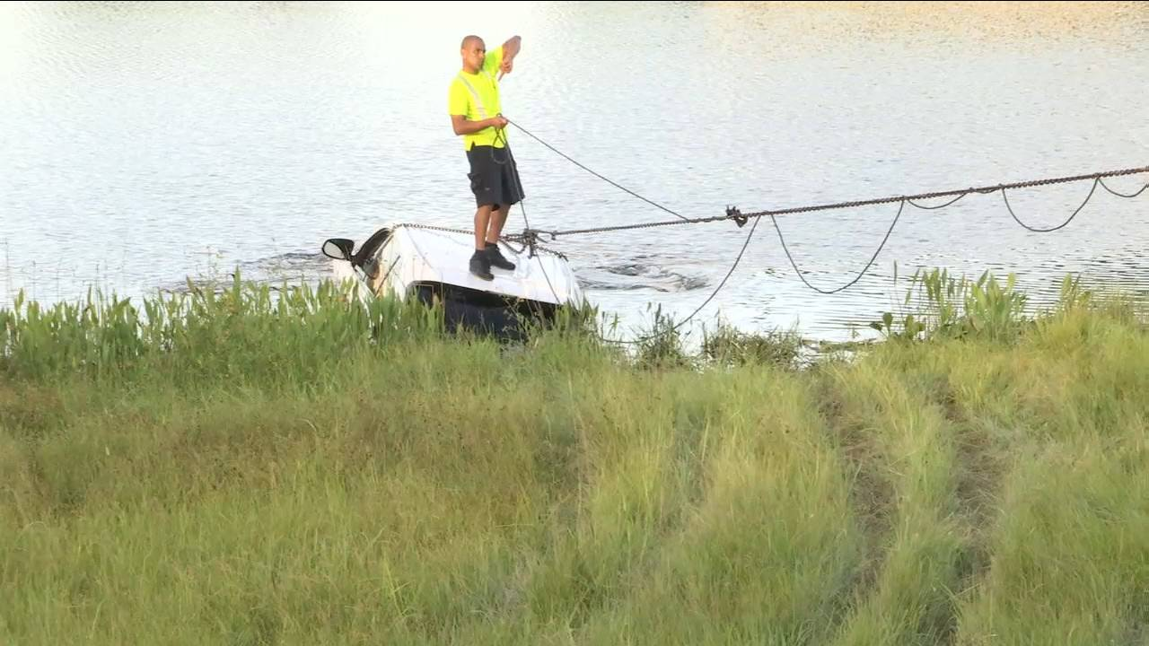 SUV being towed out of pond
