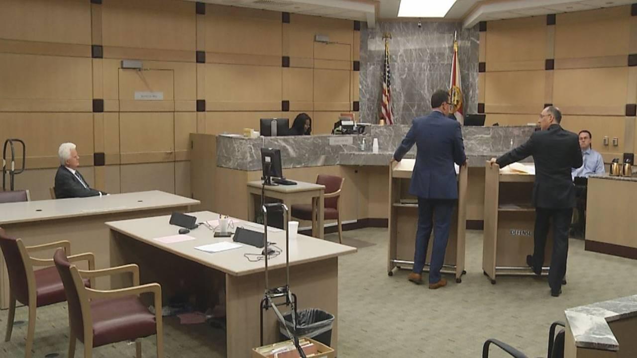 Richard Patterson listens as attorneys speak to judge