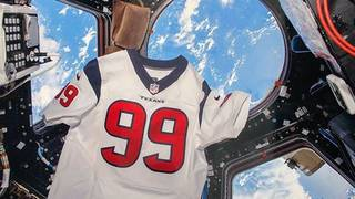 pretty nice db3b3 7a21b This is the story behind the photo of JJ Watt's jersey in space