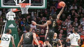Seminoles survive Miami's 3-point onslaught, win in OT