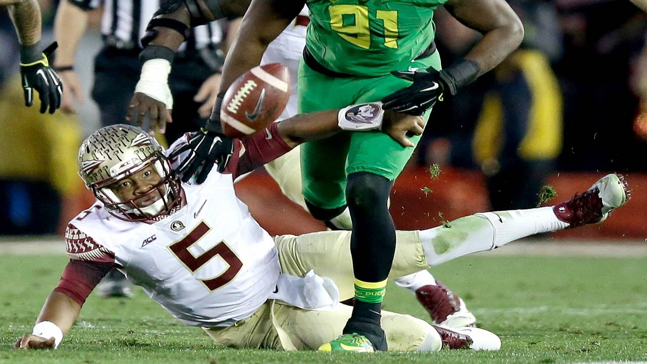 Florida State Seminoles QB Jameis Winston fumbles football vs Oregon Ducks in College Football Playoff at Rose Bowl