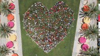 Remembering Pulse: Community members gather to form giant heart