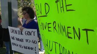 Federal workers protest government shutdown outside IRS building in Plantation