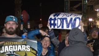 Fans gather outside closed EverBank Field to greet Jaguars