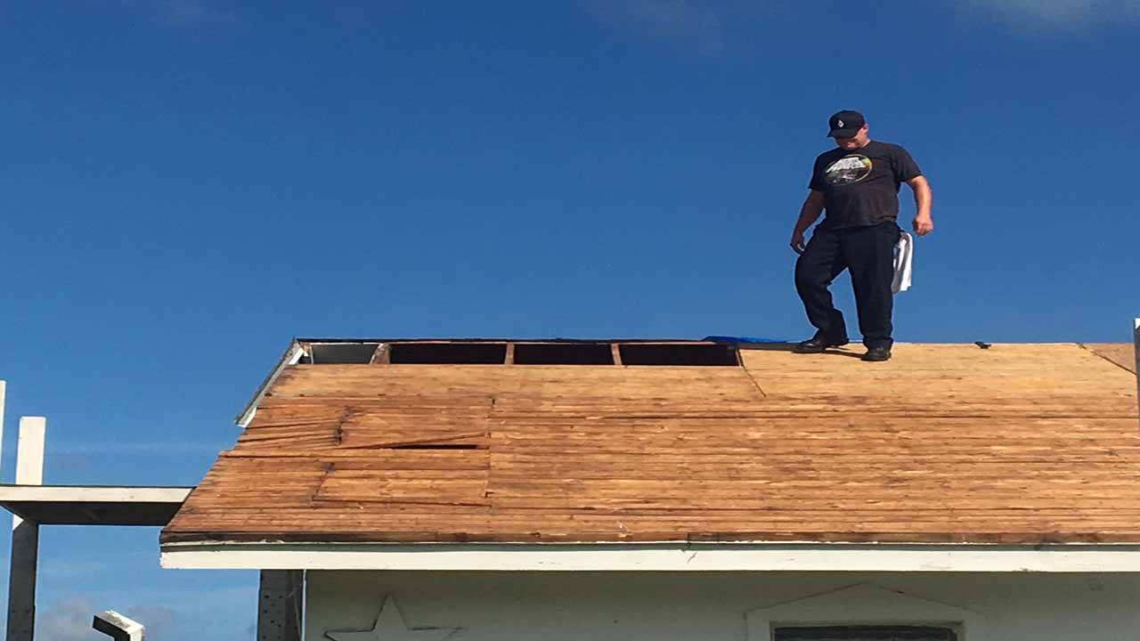 firefighters roof 3_1534096493407.jpg.jpg