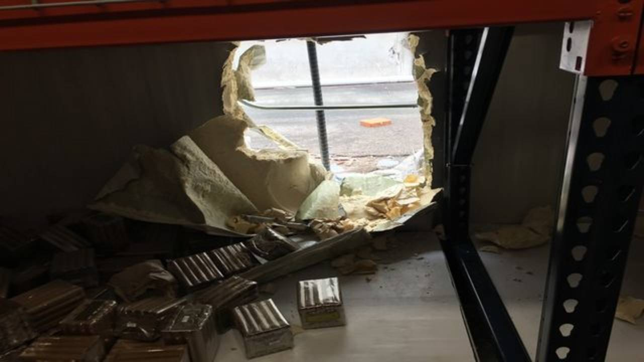 Hole in wall of cigar shop