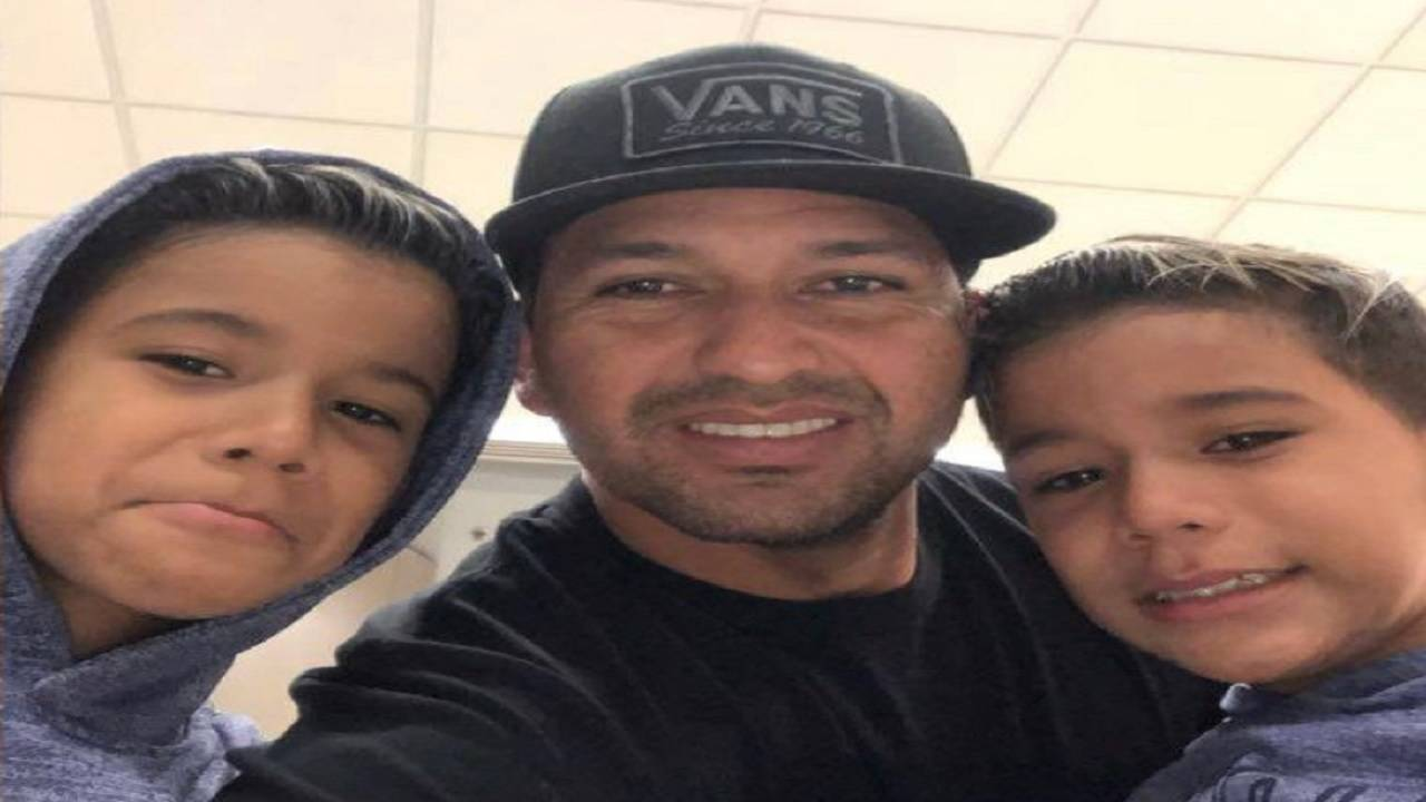 Carlos Andres Gonzalez with his sons