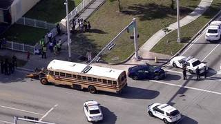 Driver crashes into school bus in Miami, tries to get away