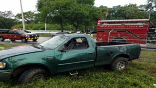 Pickup truck rolls over several times after hitting standing water on Lyons Road
