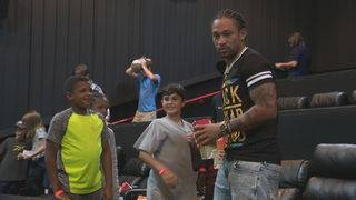 Dolphins receiver Albert Wilson takes foster families to movies