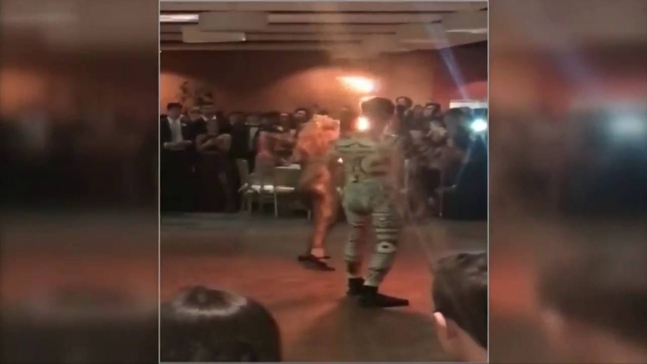 Parents outraged after caged tiger is part of high school prom_1526220759139.jpg.jpg