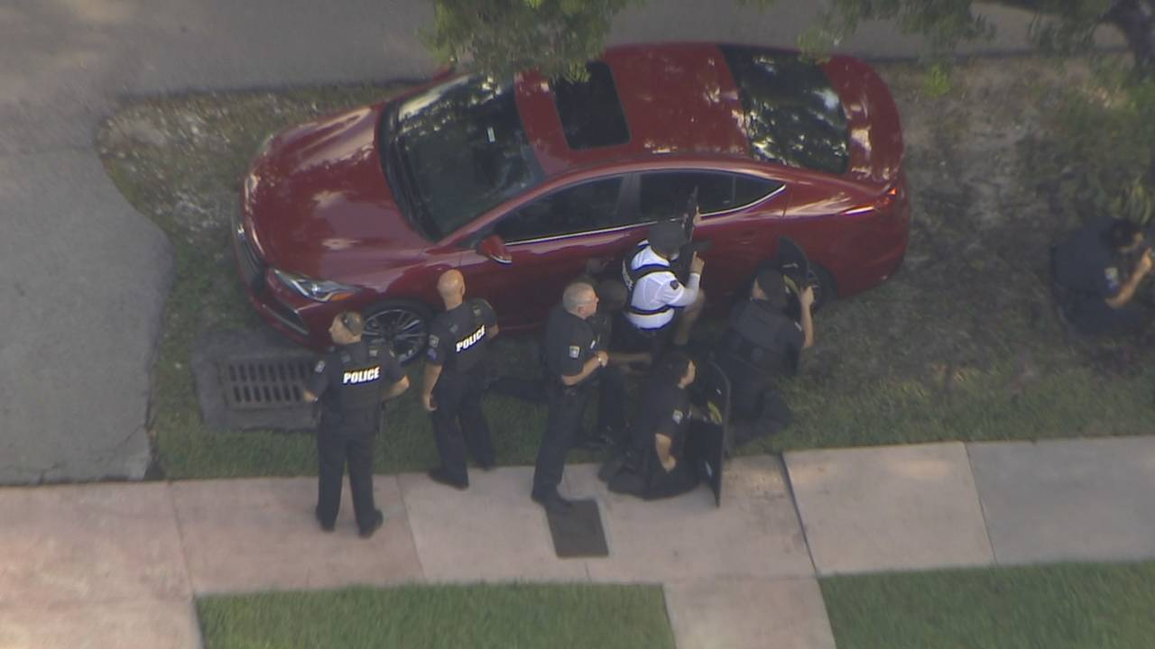 Police with guns drawn in Coral Gables