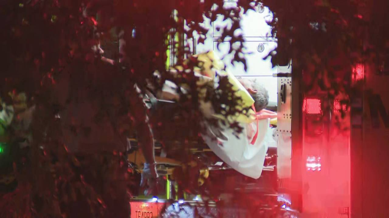Man who fell off roof placed in back of ambulance