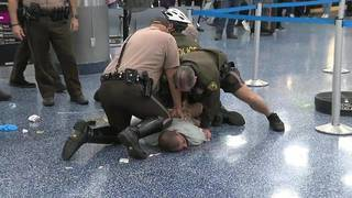 South Florida man gets 2 years for attacking Miami airport officers