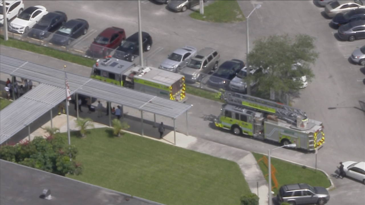 fire trucks outside carol city middle school