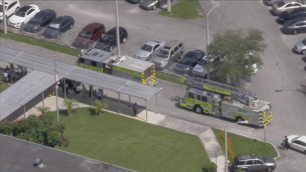 fire trucks outside carol city middle school