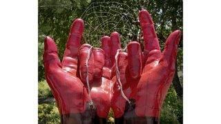 City says public art shows Spider-Man's hands, not devil horns