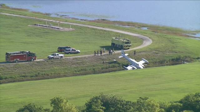 Airplane in ditch at Orlando Executive Airport