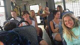 Group Smiles on Their Way to Jail After They're Busted for Underage Drinking