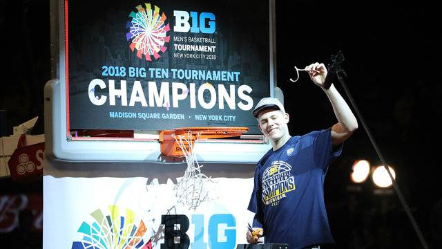 Moritz Wagner cutting down nets Big Ten Tournament championship Michigan basketball 2018