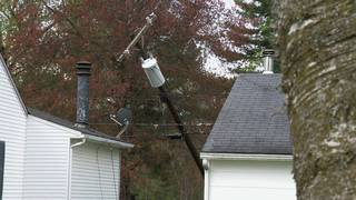 Potential danger dangles over local family's home for days!