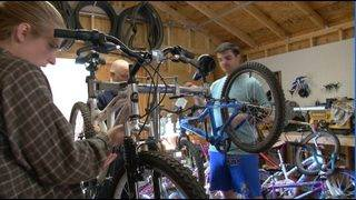 Local college students fixing, tuning up bikes for children in need