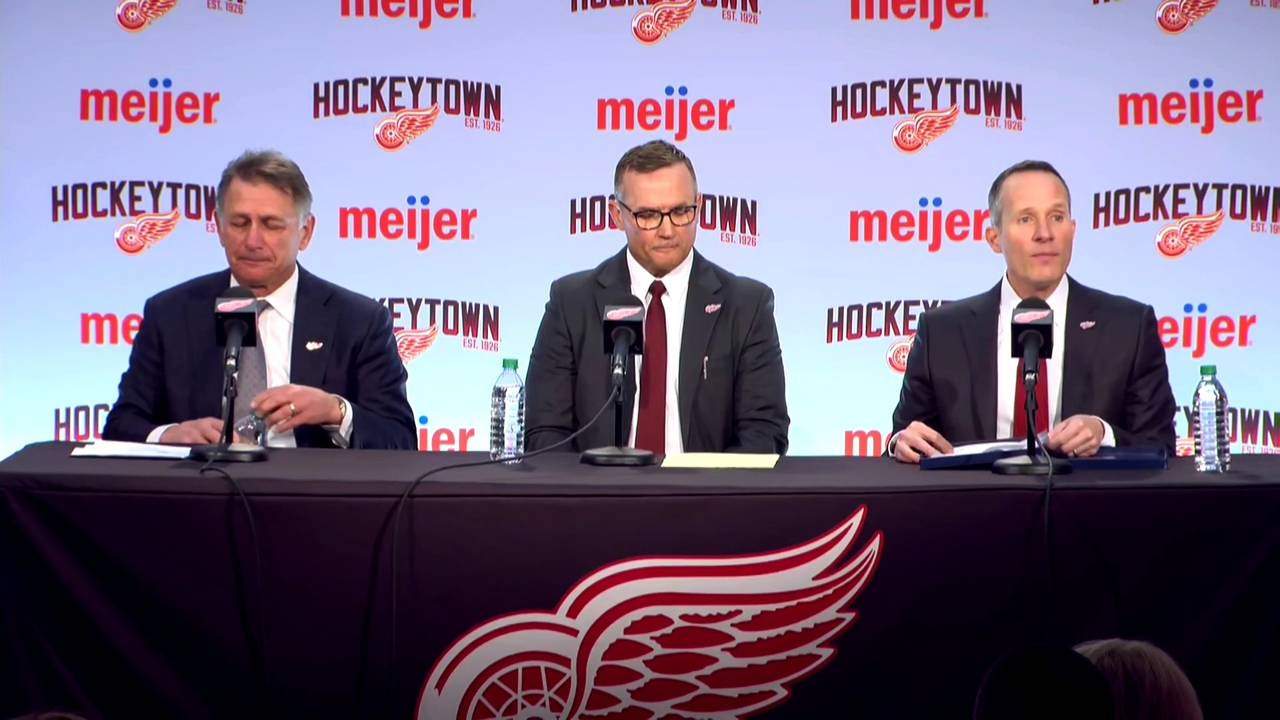 Christopher_Ilitch_Steve_Yzerman_Ken_Holland_at_press_conference_1555705738741.jpg