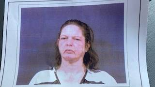 Police: Monroe County woman charged after living with dead