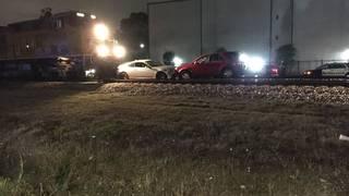 2 vehicles hit by train in northwest Houston