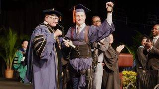 Quadriplegic College Student Walks Across Stage at Graduation Using Exoskeleton