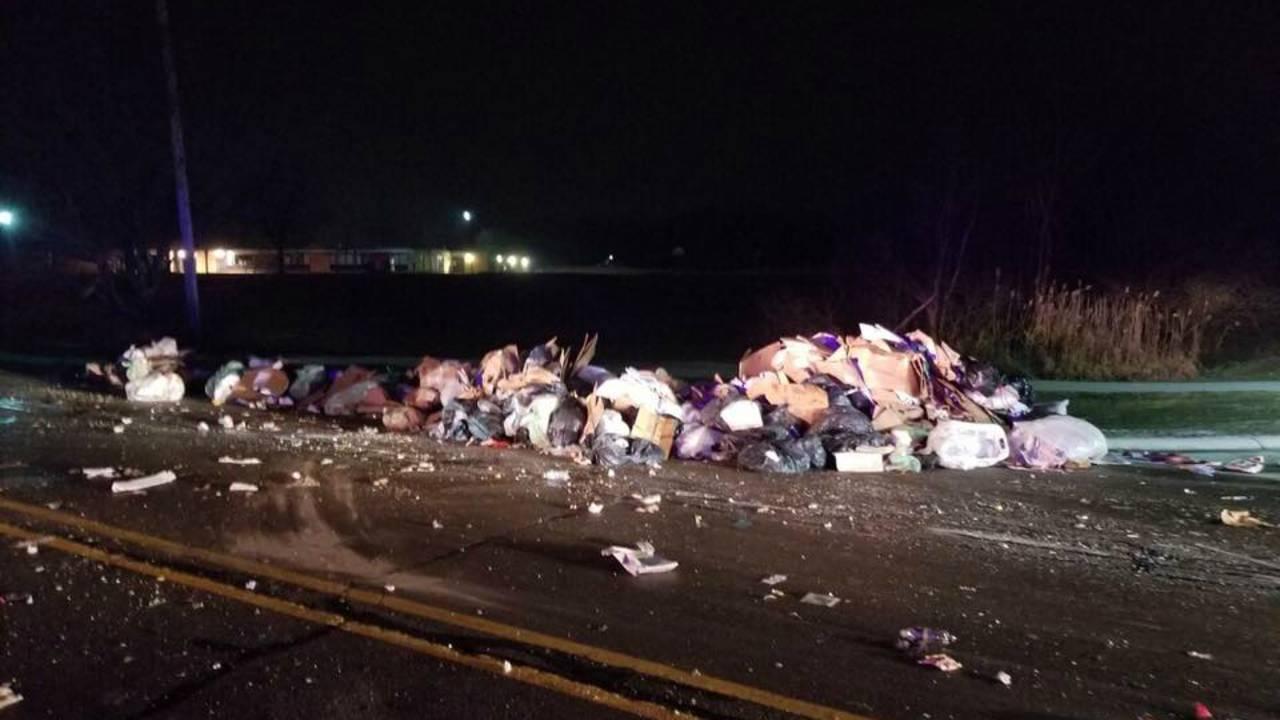 garbage truck loses load_1547817610576.jpg.jpg
