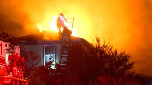 Firefighter injured, couple displaced after massive house fire in SE Houston