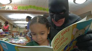 Everyday hero promotes reading -- with a mask and cape
