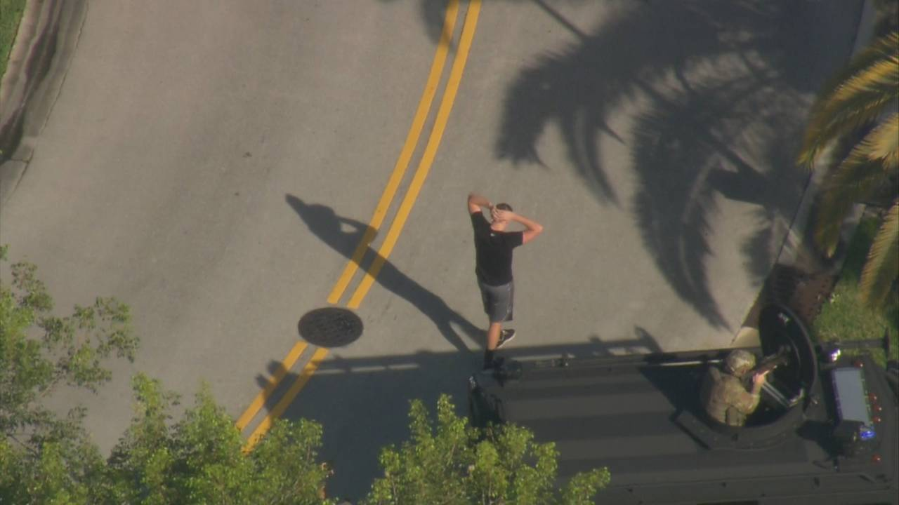 Man with hands up in Pembroke Pines